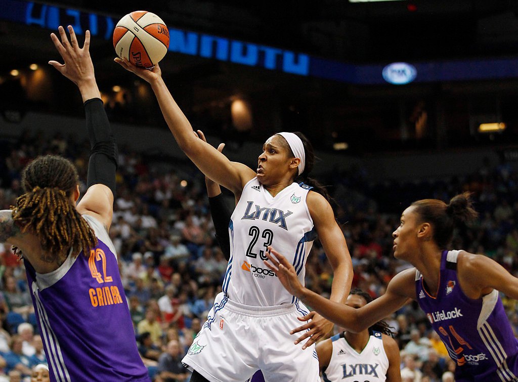 . Minnesota Lynx forward Maya Moore (23) pushes the to the basket against Phoenix Mercury center Brittney Griner (42) in the first half of a WNBA basketball game on Sunday, July 7, 2013, in Minneapolis. Moore helped lead her team to a 91-59 win over the Phoenix. (AP Photo/Stacy Bengs)