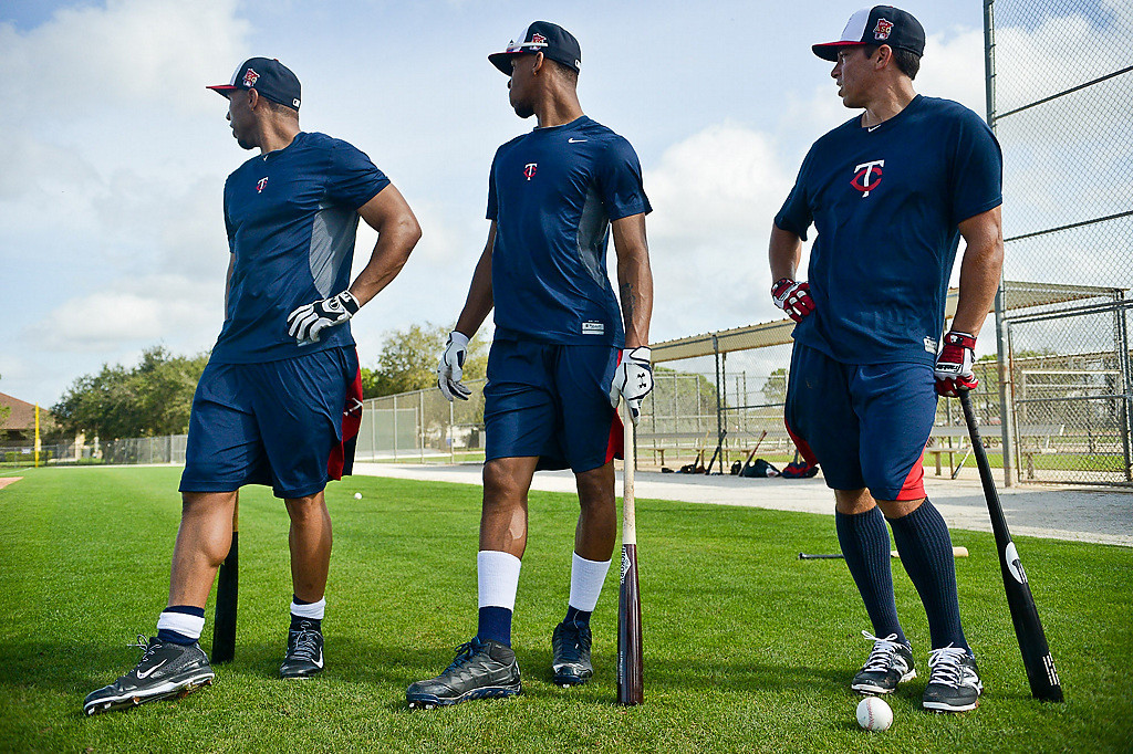 . Twins rookies Jermaine Mitchell and Byron Buxton, along with infielder Doug Bernier watch a big fly during batting practice. (Pioneer Press: Ben Garvin)