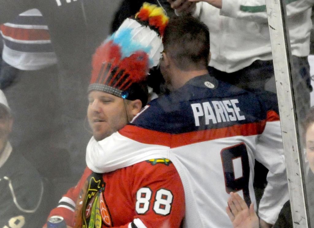 . A Wild fan puts a full Nelson on a Blackhawks fan during the second period.   (Pioneer Press: Sherri LaRose-Chiglo)
