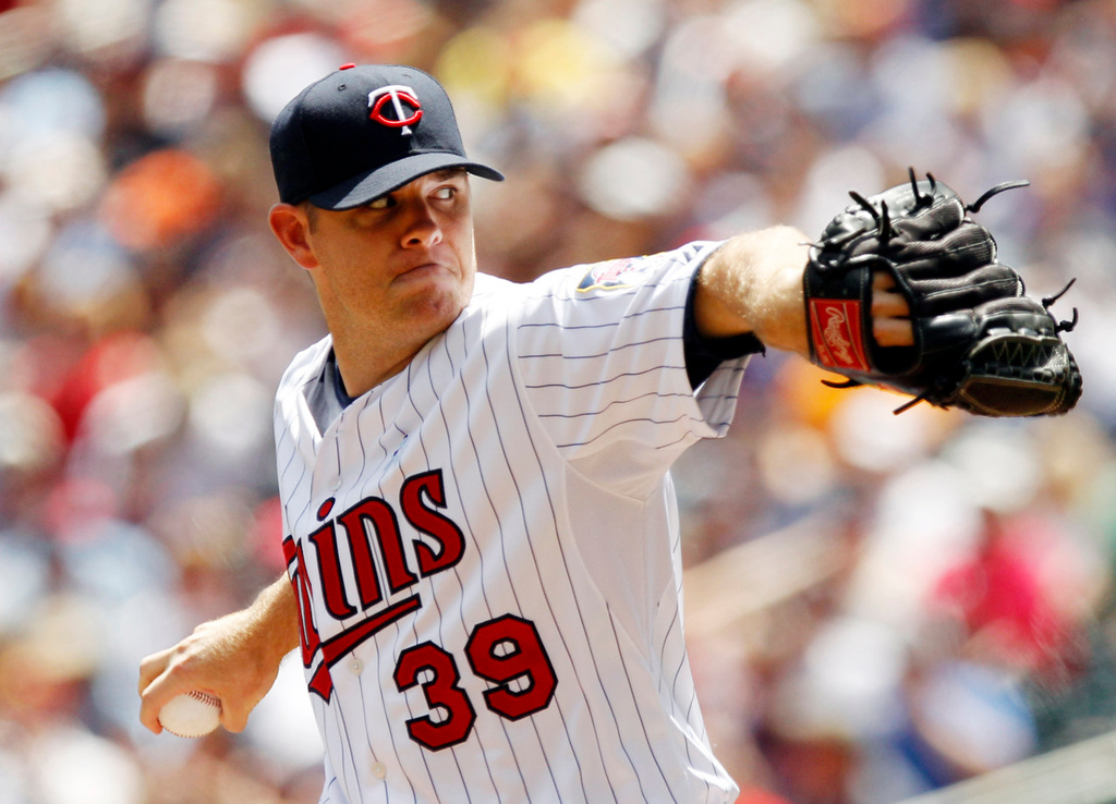 . Twins starting pitcher P.J. Walters  throws against the Tigers during the first inning. (AP Photo/Genevieve Ross)