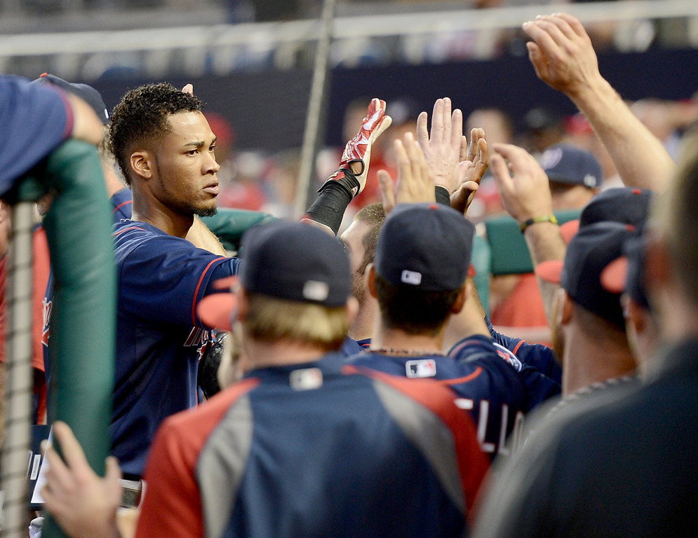 . Minnesota Twins shortstop Pedro Florimon, left, is congratulated in the dugout following his 2-run home run against the Washington Nationals in the third inning of the second game of a day-night doubleheader at Nationals Park. (Chuck Myers/MCT)