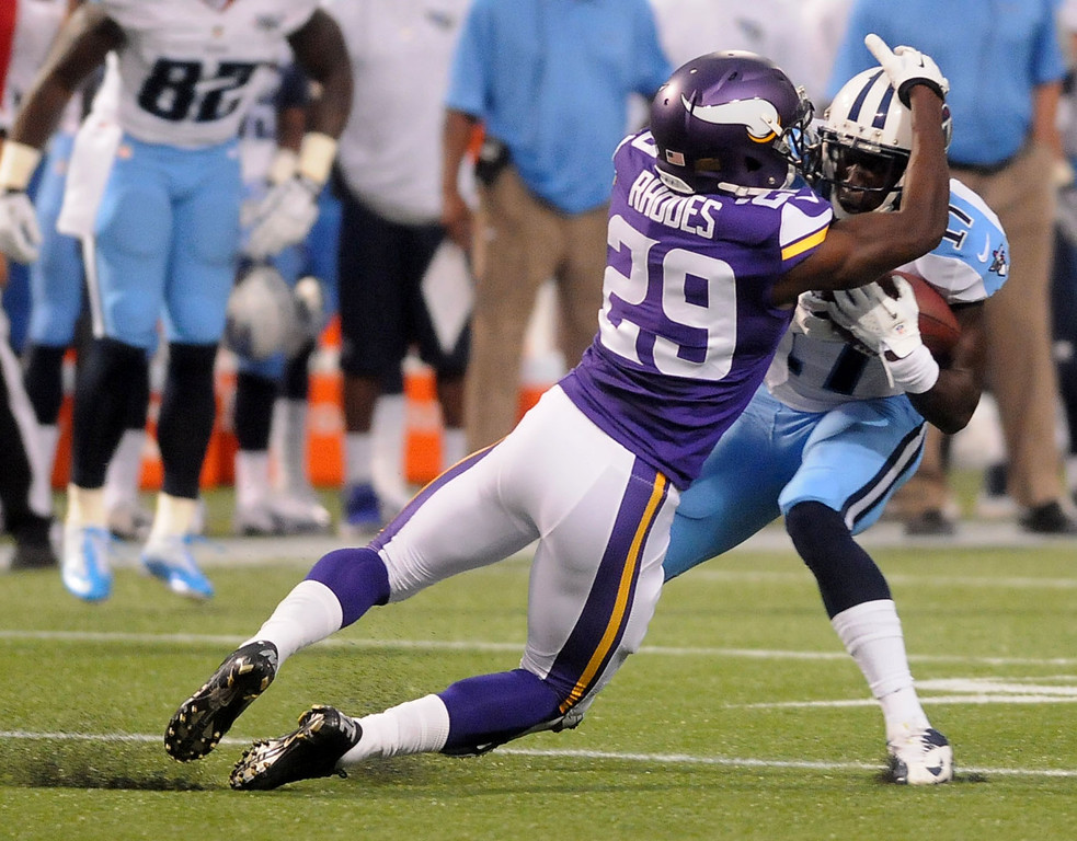 . Vikings cornerback Xavier Rhodes, left, drags Titans wide receiver Damian Williams down during the first quarter.  (Pioneer Press: Sherri LaRose-Chiglo)