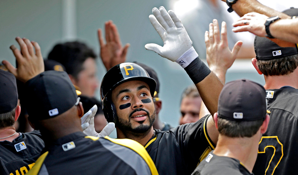 . Pirates third baseman Pedro Alvarez is greeted in the dugout after his two-run homer in the third inning off Twins starter Kevin Correia. (AP Photo/Gerald Herbert)