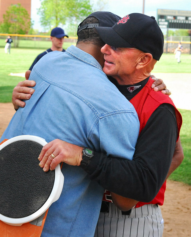 . St. Paul Central baseball coach Billy Peterson, right, gets a hug from Steve Winfield, brother of Dave Winfield, after Central won the St. Paul City Conference title, beating Harding 17-0 in St. Paul on Tuesday, May 16th, 2006. Peterson was coaxed out of retirement in 2006 to coach baseball at Central, his alma mater, and promptly led the Minutemen to the school�s first city conference championship in 78 years. (Pioneer Press: Ben Garvin)