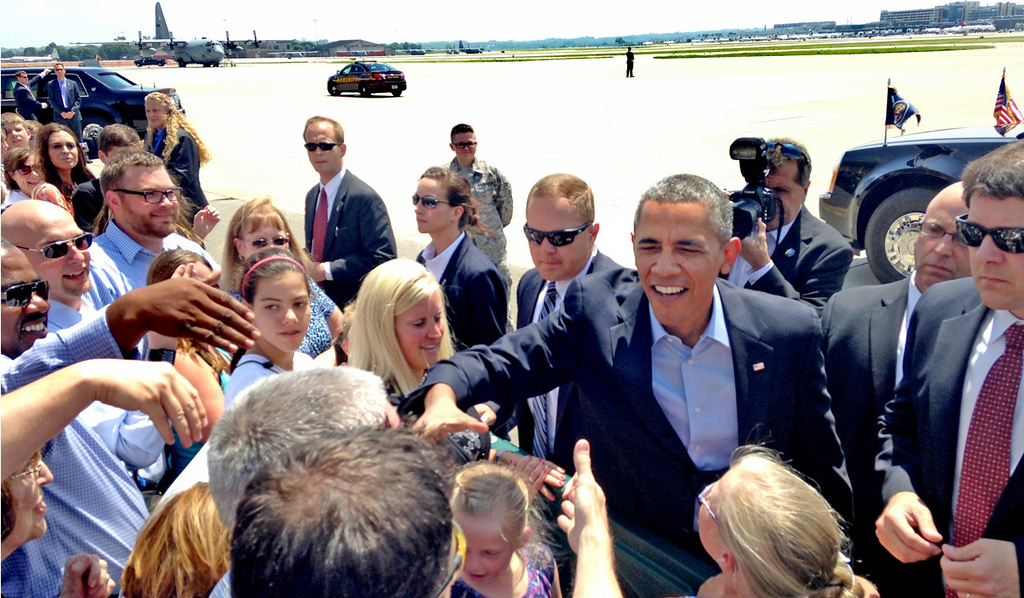 . President Barack Obama greets supporters on the tarmac after flying in Air Force One to the Minneapolis-St. Paul International Airport for his two-day visit to the Twin Cities on Thursday.  (Pioneer Press: Ben Garvin)