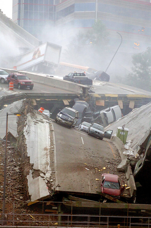 . Cars are strewn on the collapsed portion of the Interstate 35W bridge, which  stretches between Minneapolis and St. Paul, after it collapsed into the Mississippi River during evening rush hour on Wednesday August 1, 2007.  (Pioneer Press file photo: Brandi Jade Thomas)