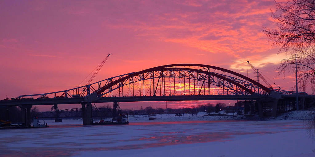 . The sun rises over the bridges on Feb. 6, 2013.  Photo courtesy of Dave Youngren/Hastings Bridge Watch.