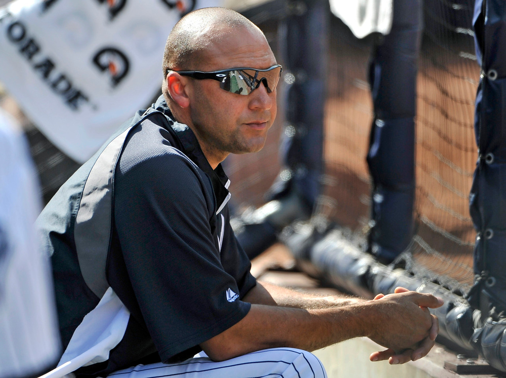 . New York\'s Derek Jeter watches the eighth inning from the dugout. Jeter is out with a strained quadricep after appearing in just one game since his return to the Yankees\' lineup. (AP Photo/Kathy Kmonicek)