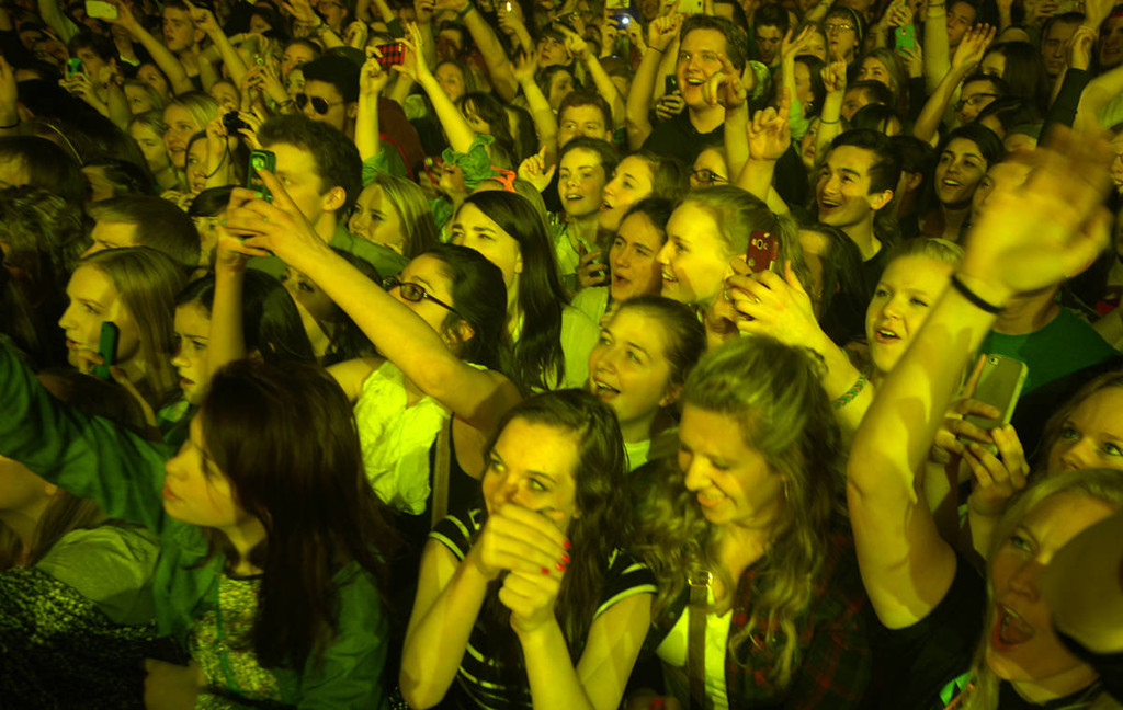 . Fans of Imagine Dragons cheer as the band takes to the stage at the Xcel Energy Center in St. Paul on Wednesday, March 12, 2014. (Pioneer Press: John Autey)