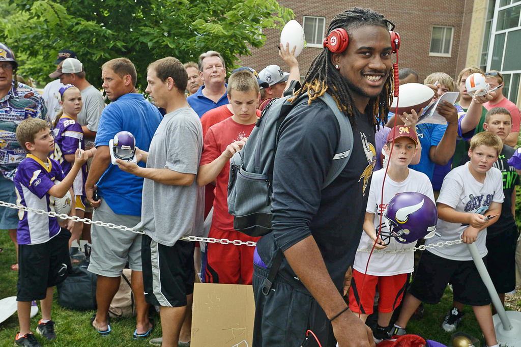 . Vikings rookie wide receiver Cordarrelle Patterson flashes a smile as he passes through the autograph line after arriving at training camp.   (Pioneer Press: Ben Garvin)