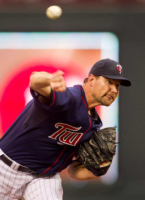 . Minnesota Twins starting pitcher Mike Pelfrey throws to the Kansas City Royals in the first inning. (AP Photo/Andy Clayton-King)