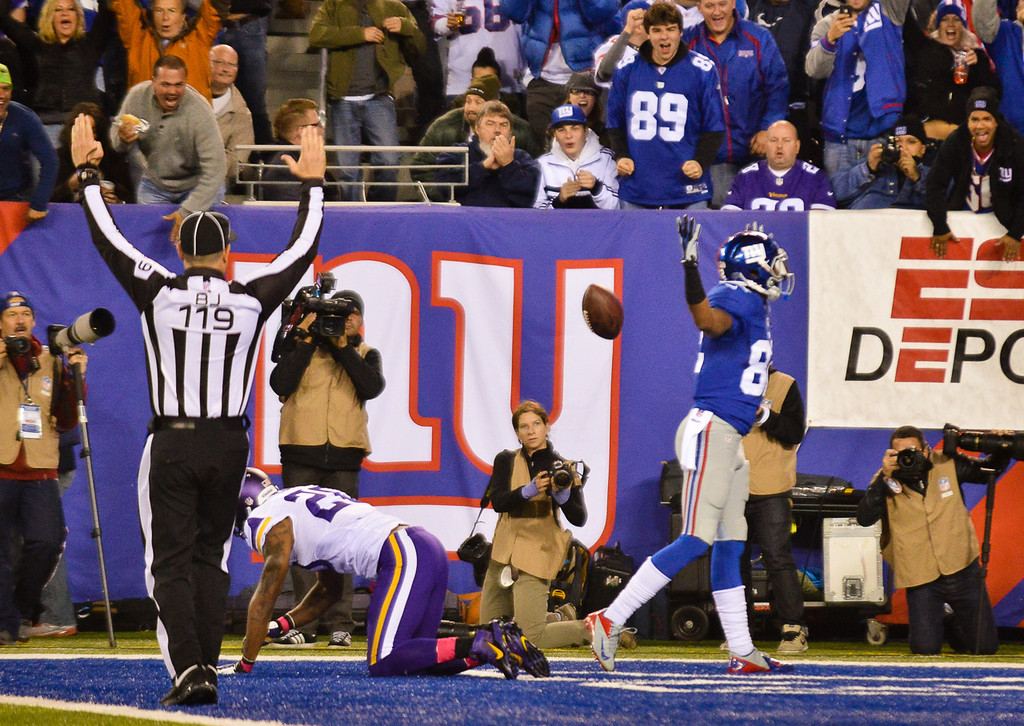 . Giants wide receiver Rueben Randle, right, celebrates his 24-yard touchdown catch as Vikings cornerback Chris Cook, left, is on his knees in the second quarter. (Pioneer Press: Ben Garvin)