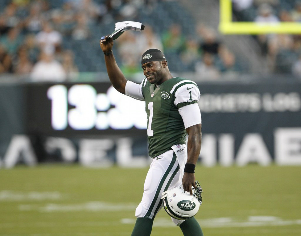 ". <p><b>NEW YORK JETS</b> </p><p><i>�No Fight in This Dog�</i> </p><p>What�s happened to Vick </p><p>That quarterback quick </p><p>So changed by that dogfighting stench </p><p>Jets are stuck with a gent </p><p>Who seems quite content </p><p>To sit behind Geno, on bench <br></p><p>PREDICTION: <b>3-13 � Last place in AFC East </b> </p><p><b><a href=""http://mmqb.si.com/2014/08/22/michael-vick-new-york-jets/\"" target=\""_blank\""> LINK </a></b> </p><p>   (Ron Cortes/Philadelphia Inquirer/MCT)</p>"