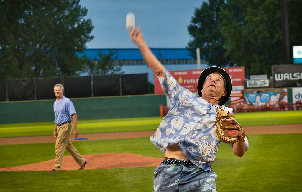 . Bill Murray launches the ball into the crowd after catching the first pitch from St. Paul Mayor Chris Coleman, background. (Pioneer Press: Ben Garvin)