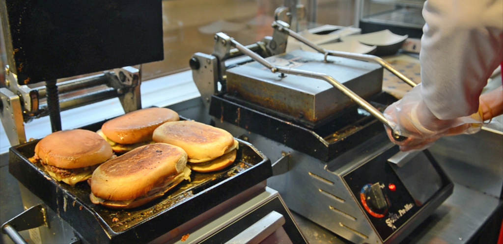 . Tony Oliva\'s Cuban sandwiches are pressed in a hot griddle before being sold to customers at Target Field. (Pioneer Press: C.J. Sinner)