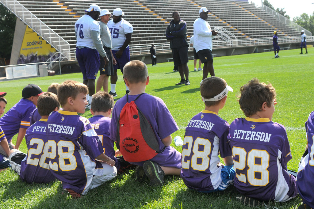 """. A slew of \""""Adrian Juniors\"""" gather on the sidelines to catch a glimpse of their hero during the Vikings\' morning drills.   (Pioneer Press: John Doman)"""