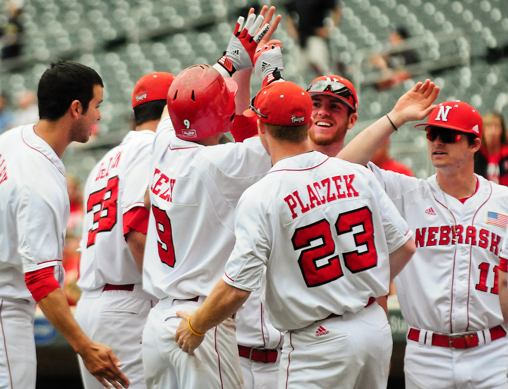 . Nebraska second baseman Pat Kelly (9) is greeted by teammates after hitting a three-run homer in the fourth inning. (Pioneer Press: Ben Garvin)