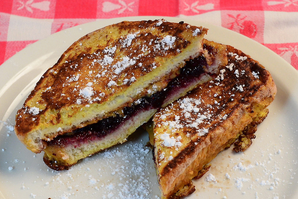 . PB&J French Toast � A peanut butter & jelly sandwich is fused with French toast, then sprinkled with powdered sugar and served with your choice of ham, bacon or sausage. At Robbinsdale OES Dining Hall, on Underwood Street next to FAN Central. (Courtesy of Minnesota State Fair)