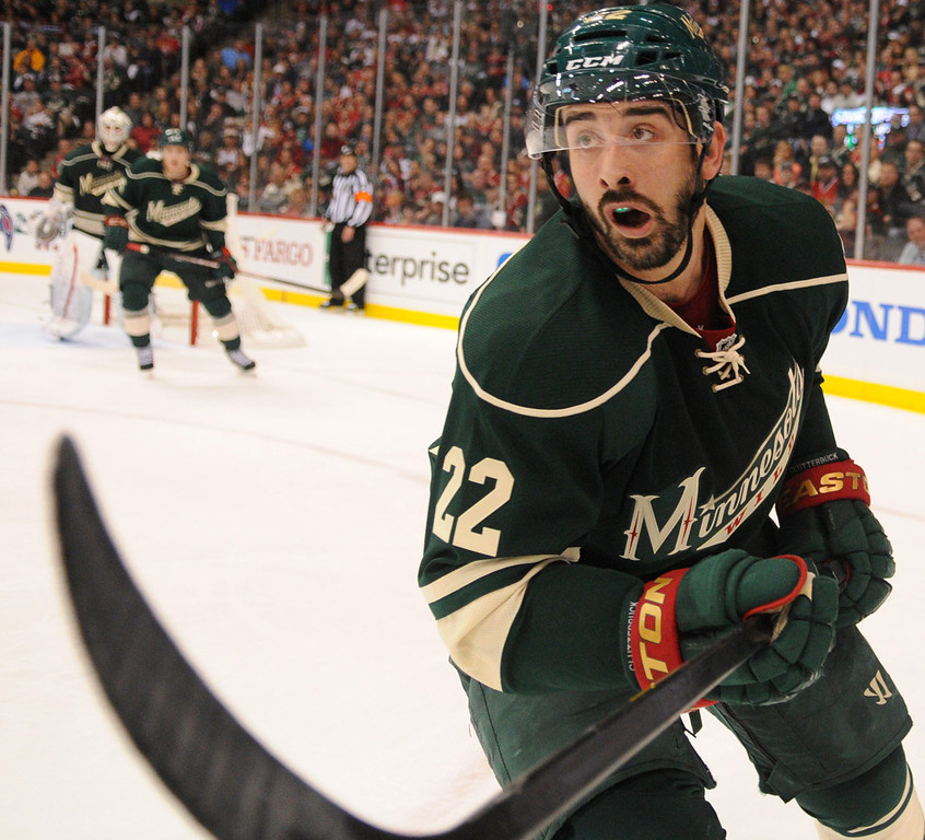 . Minnesota right wing Cal Clutterbuck looks down ice after he flips the puck out of the Wild zone against the Blackhawks during the second period. (Pioneer Press: John Autey)