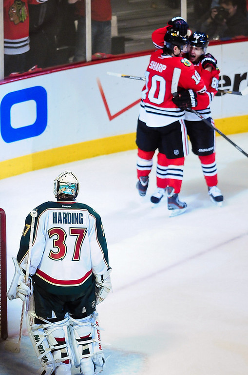 . Minnesota Wild goalie Josh Harding watches as Chicago Blackhawk players celebrate one of three goals in the third period. Minnesota lost 5-2 in Chicago on Friday, May 3, 2013, in Game 2 of the Western Conference quarterfinals. (Pioneer Press: Ben Garvin)