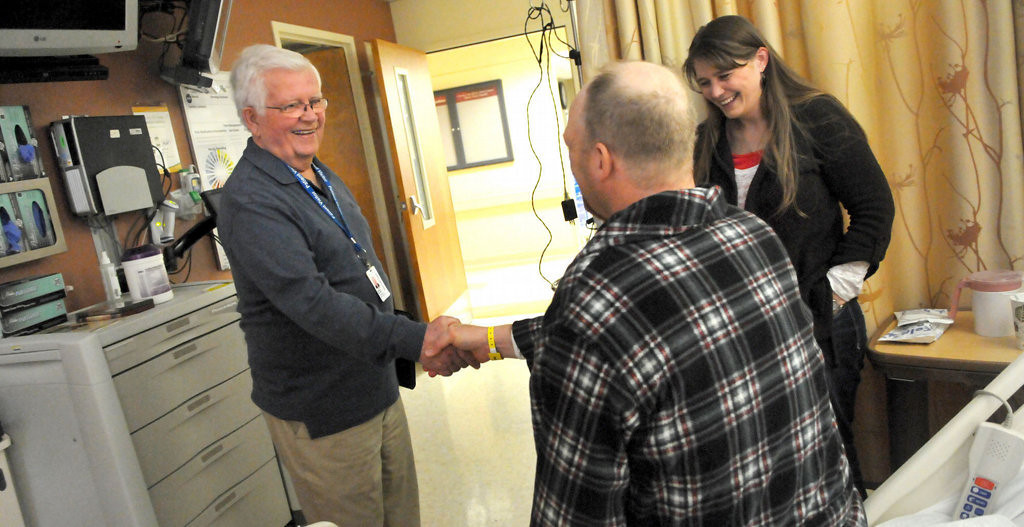 . Jerry Nelson, left, visits kidney donor Chad Konsella from Jump River, Wis., and his wife, Michael, at the University of Minnesota Medical Center, Fairview. (Pioneer Press: John Doman)