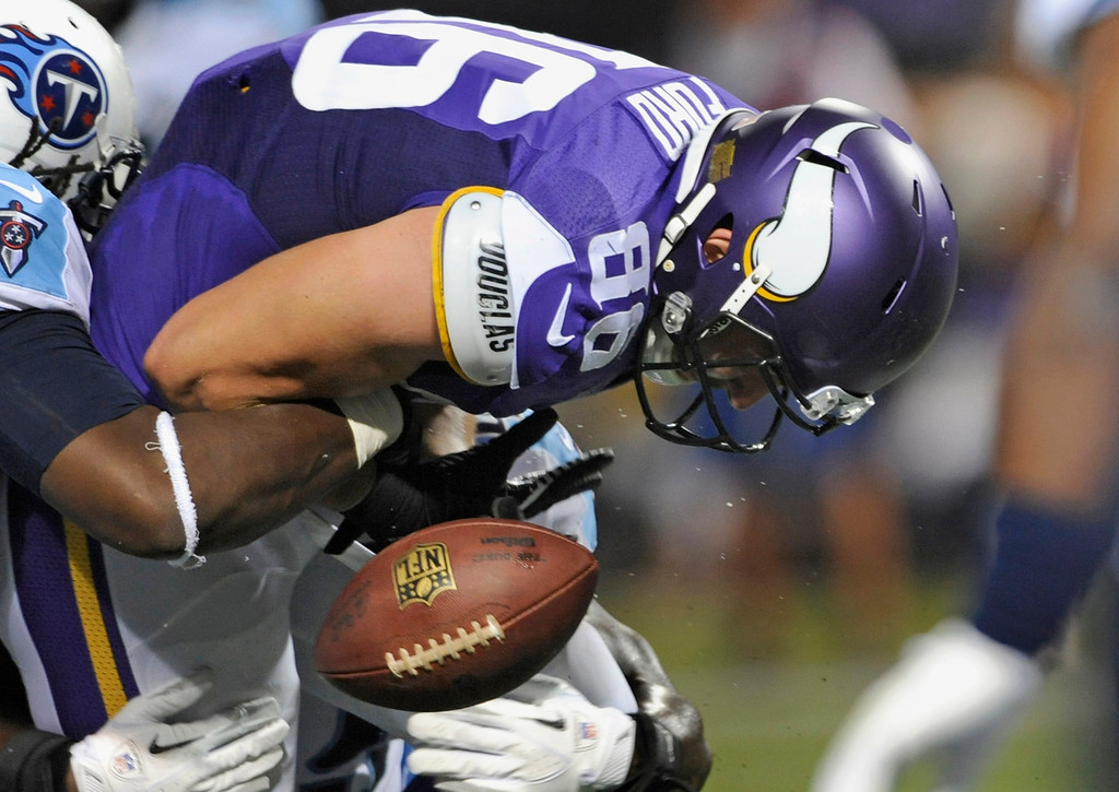 . Minnesota tight end Chase Ford fumbles the ball during the third quarter against the Titans, who recovered the ball. The fumble recovery was challenged, and the play was upheld.  (Photo by Hannah Foslien/Getty Images)