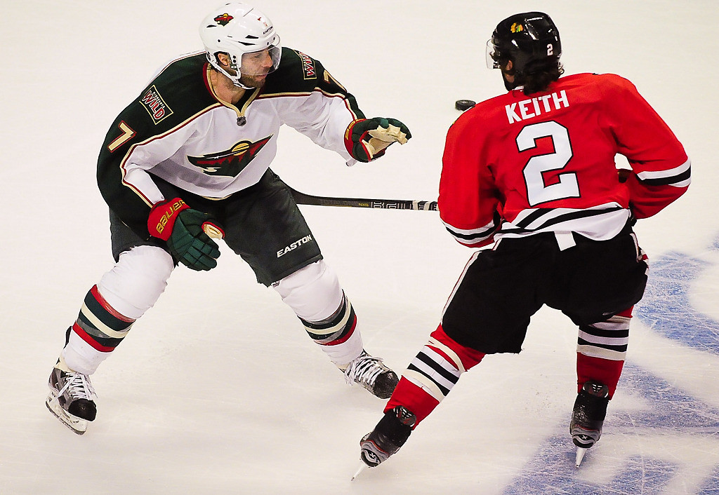 . During a power play in the third period, Minnesota Wild center Matt Cullen tries to play defense without his stick on Chicago Blackhawks defenseman Duncan Keith.  (Pioneer Press: Ben Garvin)