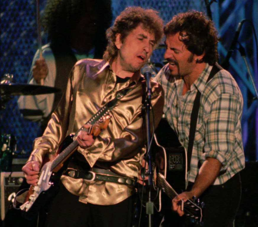 . 1995: Bob Dylan is joined by Bruce Springsteen, right, during Dylan\'s set for the Rock and Roll Hall of Fame benefit concert Saturday night, Sept. 2, 1995, in Cleveland. (AP Photo/Tony Dejak)