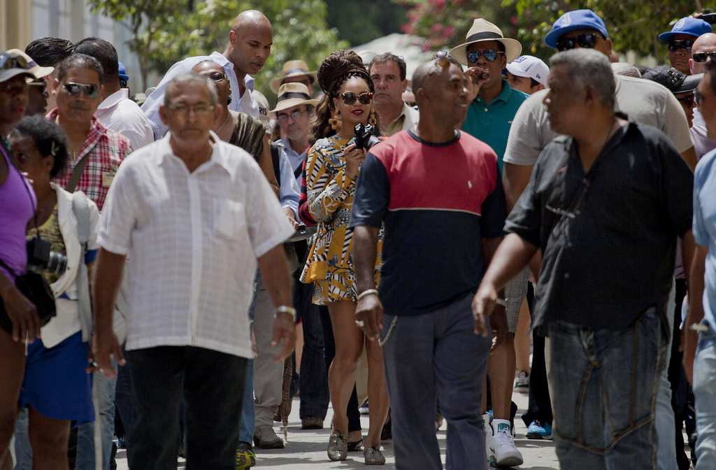 . Beyonce, center holding camera, walks with Jay-Z as they tour Old Havana. (Associated Press: Ramon Espinosa)