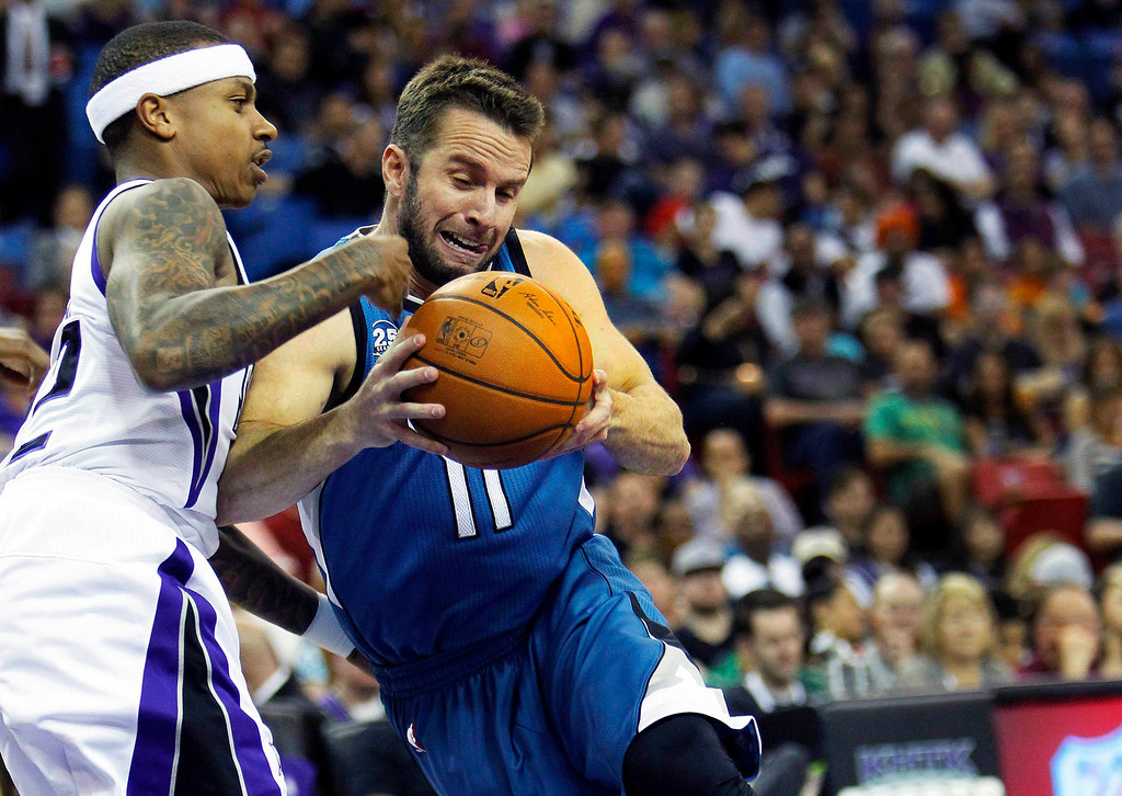 . Minnesota Timberwolves guard Jose Barea (11) drives to the basket against Sacramento Kings defender Isaiah Thomas during the first half of an NBA basketball game in Sacramento, Calif., on Sunday, April 13, 2014.(AP Photo/Steve Yeater)