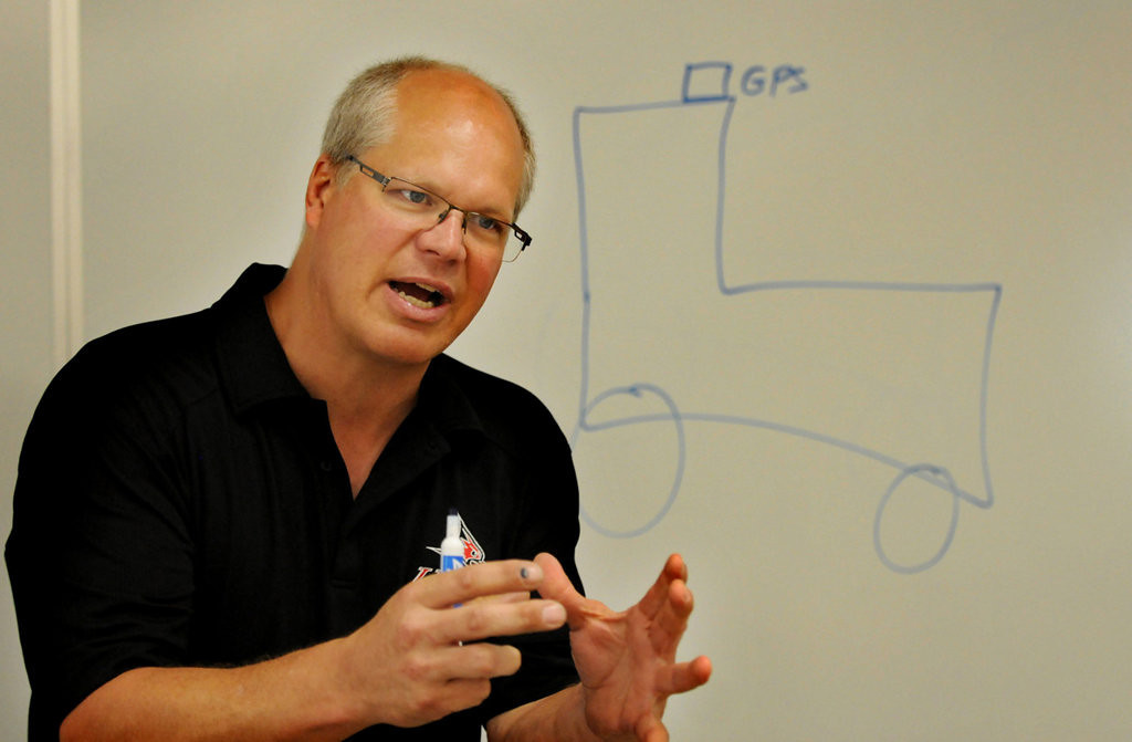 . Dean Olson, an associate dean at the University of Wisconsin-River Falls, talks to students about the Global Positioning System on tractors during the Camp Badger Exploring Engineering program. (Pioneer Press: Jean Pieri)
