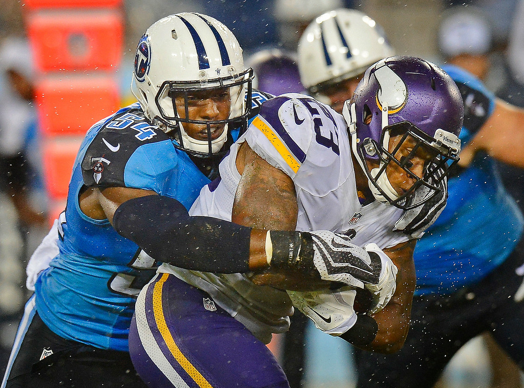 . Minnesota Vikings running back Joe Banyard  is stopped by Tennessee Titans linebacker Avery Williamson in the second quarter. (AP Photo/Mark Zaleski)