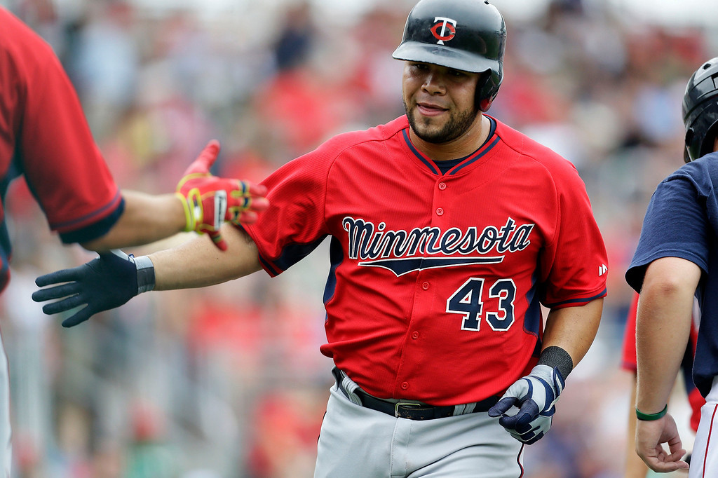 . Minnesota Twins\' Josmil Pinto (43) is greeted after hitting a three-run home run during the seventh inning of an exhibition baseball game against the Boston Red Sox in Fort Myers, Fla., Saturday, March 29, 2014. (AP Photo/Gerald Herbert)