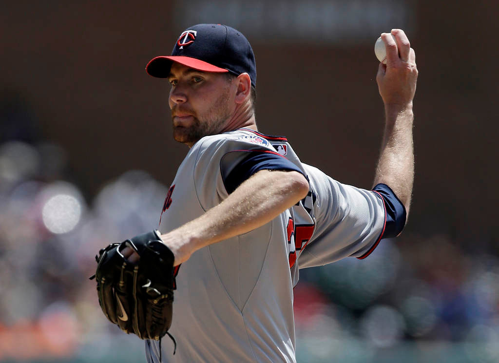 . Minnesota Twins starting pitcher Mike Pelfrey throws during the first inning.(AP Photo/Carlos Osorio)