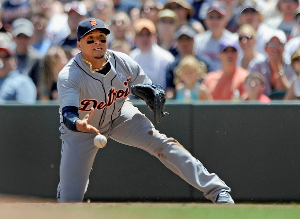 . Tigers first baseman Victor Martinez feeds the ball to pitcher Doug Fister (not seen, covering first) to get Minnesota\'s Ryan Doumit out on a grounder to end the first inning.  (Photo by Hannah Foslien/Getty Images)