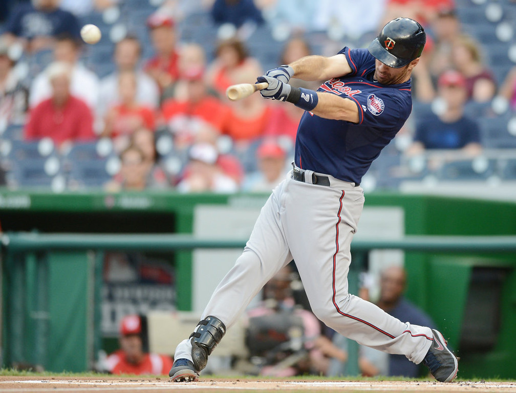 . Minnesota Twins first baseman Joe Mauer (7) hits a double against the Washington Nationals in the first inning of the second game of a day-night doubleheader.  (Chuck Myers/MCT)