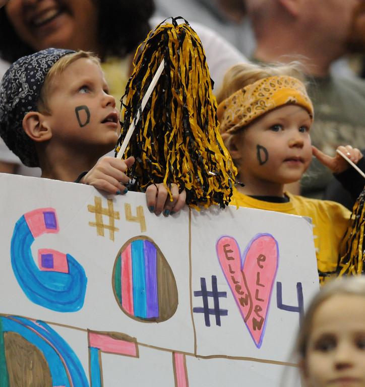 . Two young DeLaSalle Islanders fans watch the game. (Pioneer Press: John Autey)