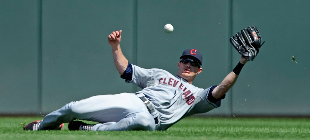 . Indians center fielder Drew Stubbs  misses a catch that went for a double by Minnesota\'s Brian Dozier during the seventh inning, thte first and only hit allowed by Cleveland starter Justin Masterson.   (Photo by Hannah Foslien/Getty Images)
