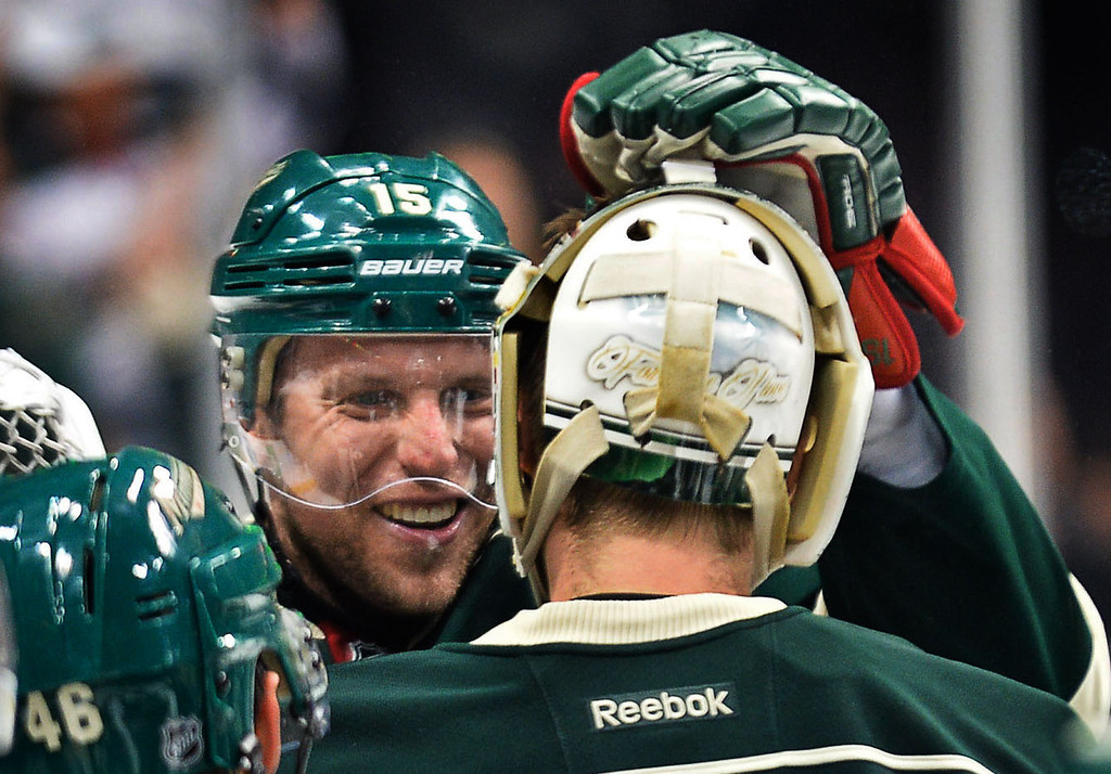 . Minnesota Wild left wing Dany Heatley gives goalie Darcy Kuemper a tap after the game. (Pioneer Press: Ben Garvin)