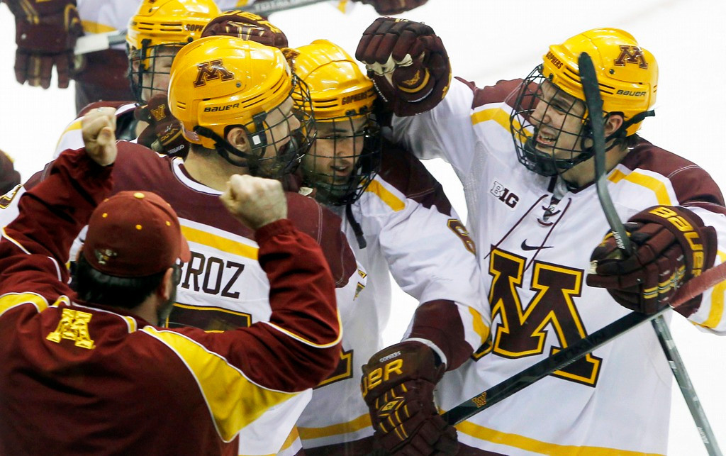. Minnesota\'s Seth Ambroz, left, celebrates with teammates Jake Parenteau, center, and Brady Skjei, right, after Ambroz scored the game-winning shootout goal in the Gophers\' 5-4 win over Minnesota Duluth 5-4 in the North Star College Cup championship game at Xcel Energy Center in St. Paul on Saturday, January 25, 2014. (AP Photo/Ann Heisenfelt)