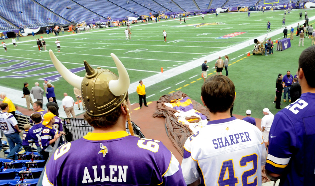 ". From left: Justin Morken, Ethan Ryan and Kevin Brown watch pregame warm -ps at the Metrodome. Morken added that ""I will probably cry when they tear it down. They (Vikings) are tearing it down on my 21st Birthday in February.\"" (Pioneer Press: Sherri LaRose-Chiglo)"