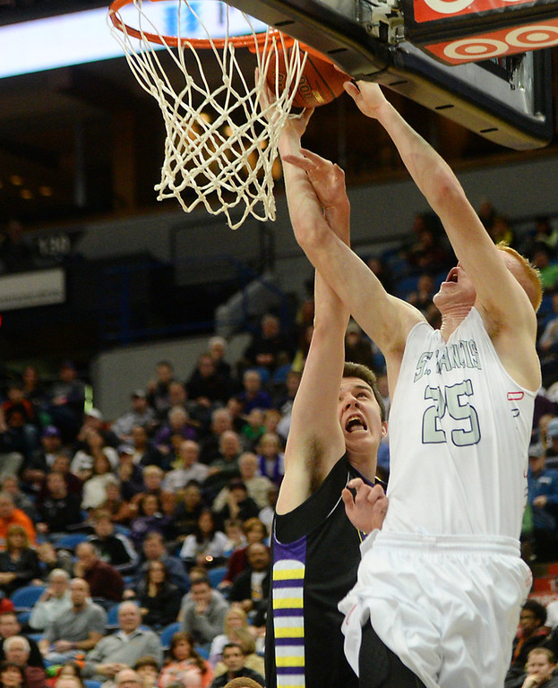 . Cretin-Derham Hall junior forward Frank Delaney, left, gets away with a foul as St. Francis senior forward Jake Johnson tries for the dunk during the first half. (Pioneer Press: John Autey)