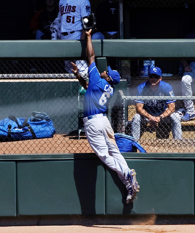 . Royals center fielder Lorenzo Cain robs Minnesota\'s Trevor Plouffe of a homwe run during the fifth inning. (Photo by Hannah Foslien/Getty Images)