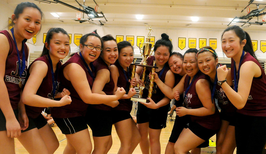 . The Johnson High School badminton team poses with the team championship trophy at the end of team play at the Minnesota State Badminton Tournament.  (Pioneer Press: John Autey)