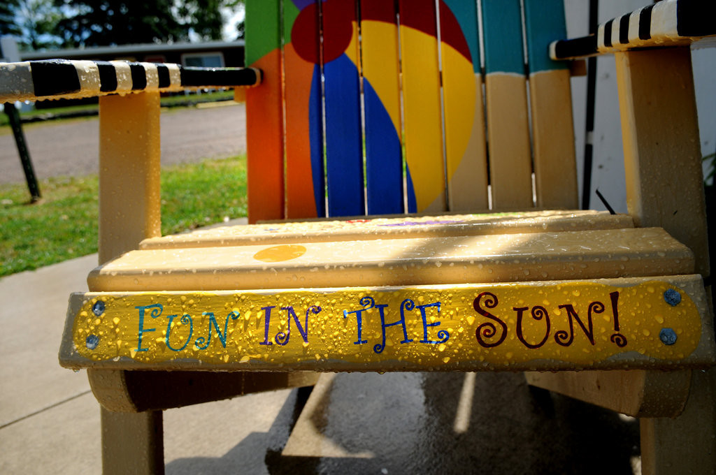 """. A chair titled \""""Fun in the Sun\"""" sat covered in rain in front of Cotton Candy Ice Cream Shop in Center City, Minnesota Friday July 26, 2013. (Pioneer Press: Jean Pieri)"""