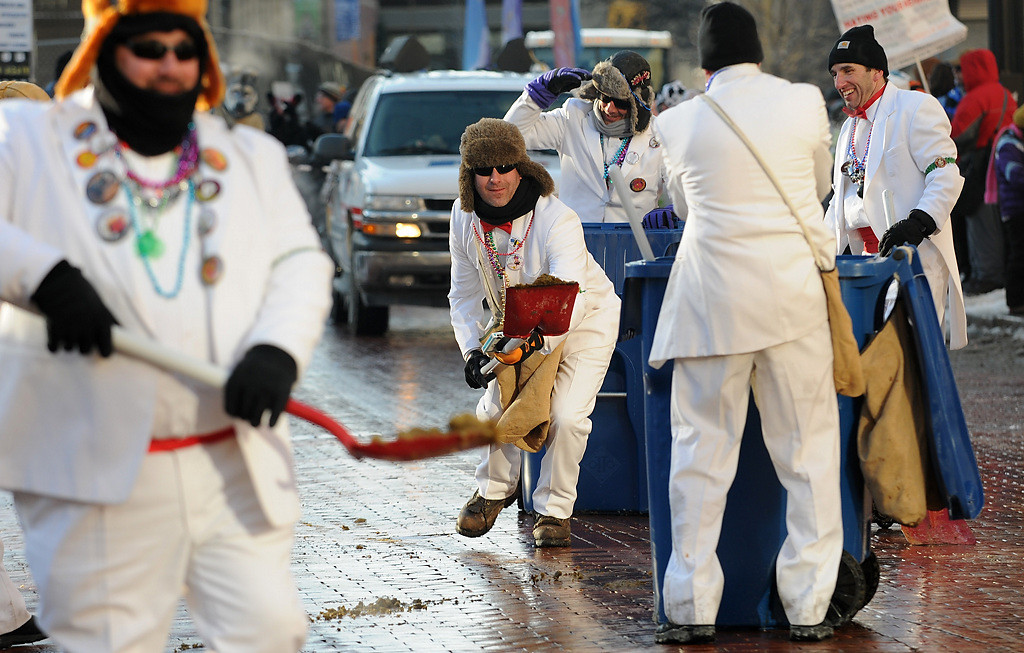 . The Tux Team happily scoops up after the horses at the Winter Carnival Grande Day Parade in St. Paul, Saturday January 25, 2014. (Pioneer Press: Jean Pieri)