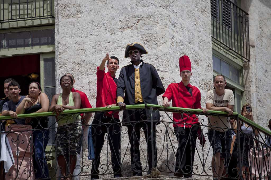 . Workers at the La Moneda Cubana restaurant stand on a balcony to watch the arrival of Beyonce and Jay-Z. (Associated Press: Ramon Espinosa)