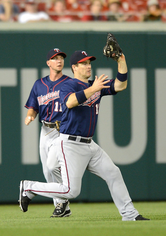 . Minnesota Twins left fielder Josh Willingham (16) makes a running catch ahead of Twins left fielder Clete Thomas (11) on a fly ball hit by Washington Nationals left fielder Stephen Lombardozzi in the sixth  inning of the second game of a day-night doubleheader at Nationals Park. (Chuck Myers/MCT)