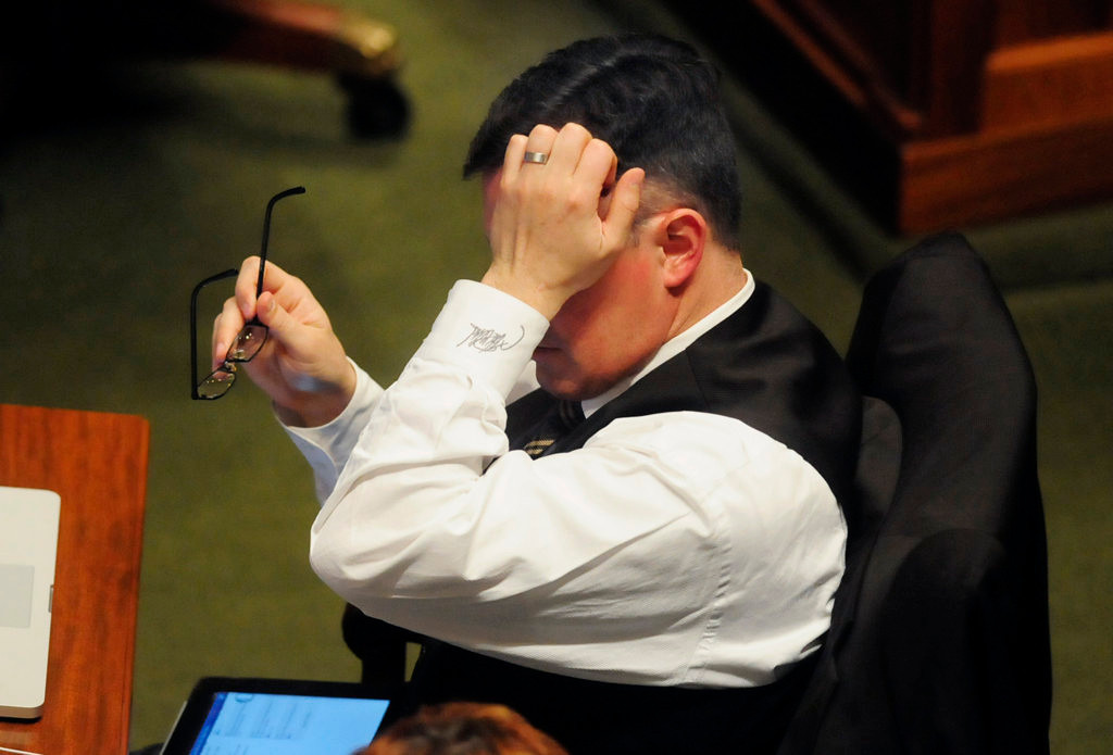 . Rep. John Lesch, DFL-St. Paul, rubs his head with weariness late in the evening as the House of Representatives winds up business Monday night, May 20, 2013. (Pioneer Press: Scott Takushi)