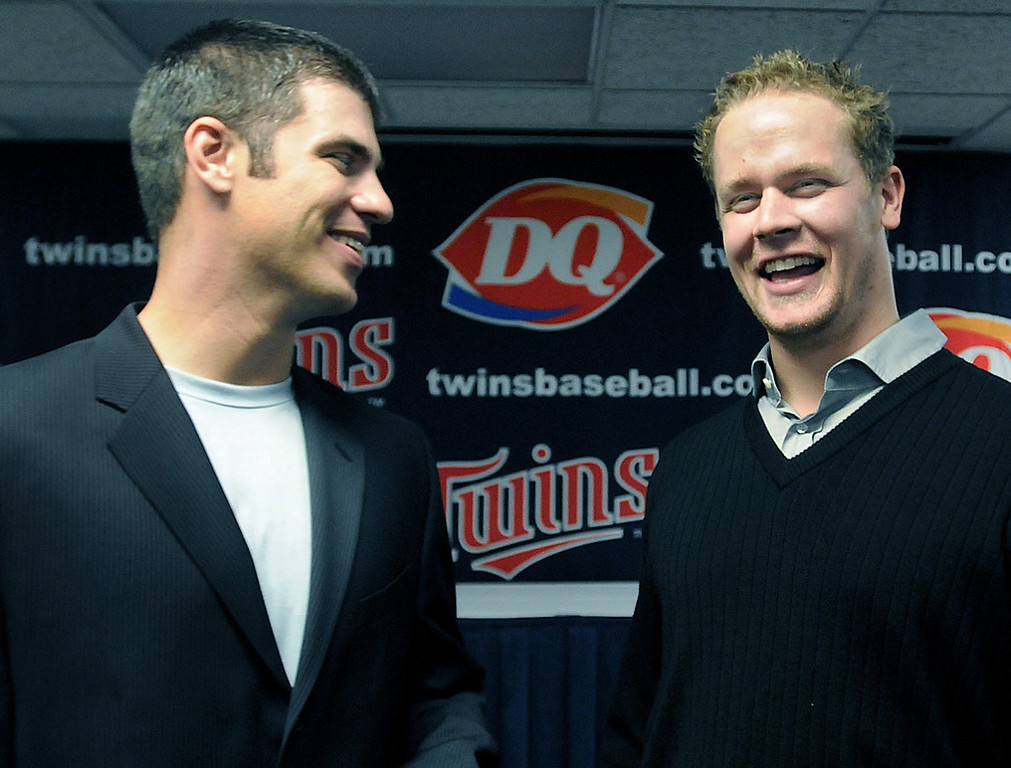 . Minnesota Twins catcher Joe Mauer, chosen as the American League\'s Most Valuable Player, chats with teammate Justin Morneau, right, following a press conference at the Metrodome in Minneapolis on Monday November 23, 2009.   (Pioneer Press: Richard Marshall)